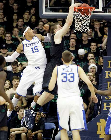 Notre Dame's Jack Cooley, center, slams it home, leaving Kentucky's Willie Cauley-Stein in his wake. Photo: Mark Cornelison, MBR / Lexington Herald-Leader