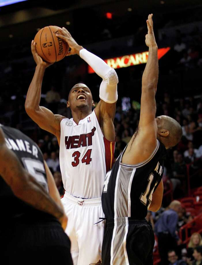 Miami Heat's Ray Allen (34) shoots over San Antonio Spurs' Gary Neal (14) in the second half of an NBA basketball game in Miami, Thursday, Nov. 29, 2012, in Miami. Miami won 105-100. ( AP Photo/Alan Diaz) Photo: Alan Diaz
