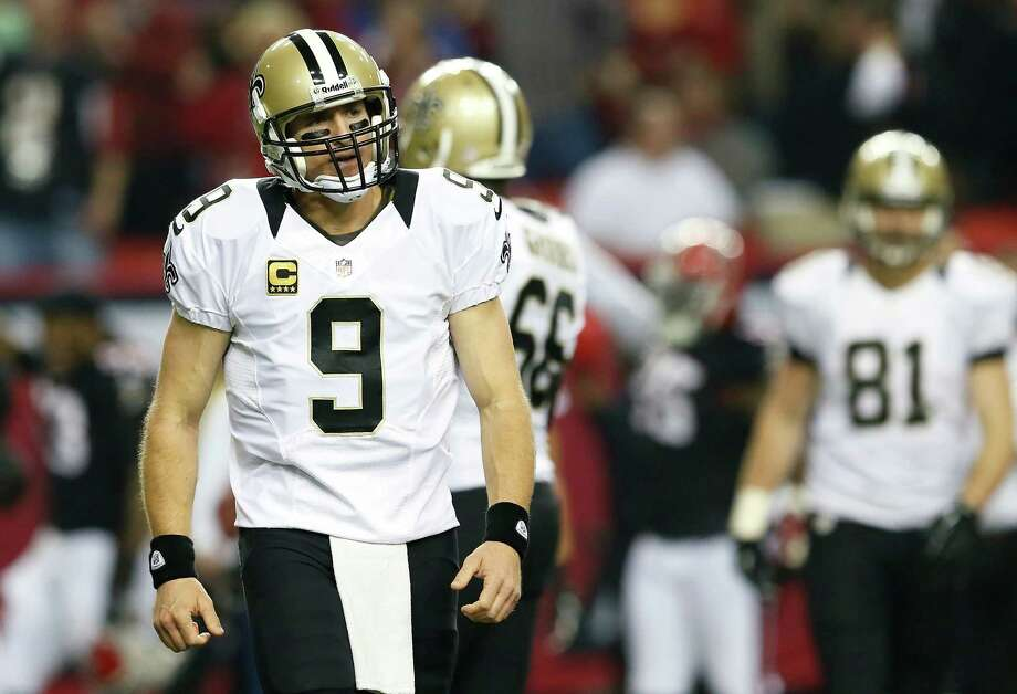 Saints quarterback Drew Brees (9) walks off the field dejected after throwing one of a career-high five interceptions in Thursday night's loss to the Falcons. Photo: Kevin C. Cox, Staff / 2012 Getty Images