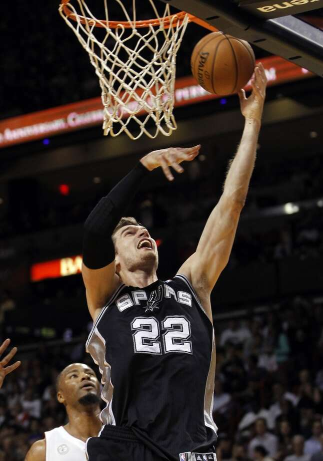 San Antonio Spurs' Tiago Splitter (22) goes to the basket against the Miami Heat in the first half of an NBA basketball game on Thursday, Nov. 29, 2012, in Miami.