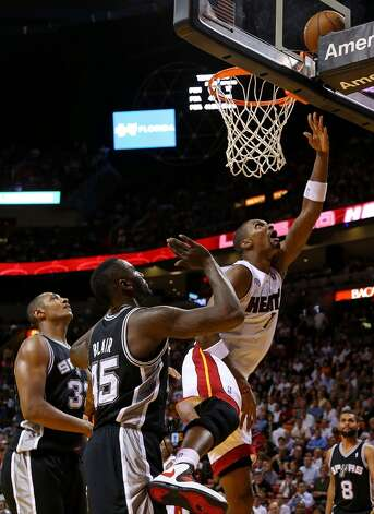 Chris Bosh #1 of the Miami Heat drives to the basket during a game against the San Antonio Spurs at American Airlines Arena on November 29, 2012 in Miami, Florida.