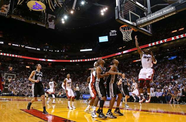 Dwyane Wade #3 of the Miami Heat drives to the rim during a game against the San Antonio Spurs at American Airlines Arena on November 29, 2012 in Miami, Florida.