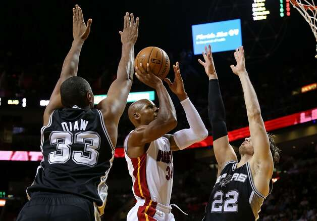 Ray Allen #34 of the Miami Heat shoots over Tiago Splitter #22 of the San Antonio Spurs during a game  at American Airlines Arena on November 29, 2012 in Miami, Florida.