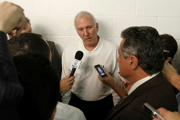 Spurs head coach Gregg Popovich talks to reporters before an NBA basketball game against the Miami Heat, Thursday, Nov. 29, 2012, in Miami. ( AP Photo/Alan Diaz)