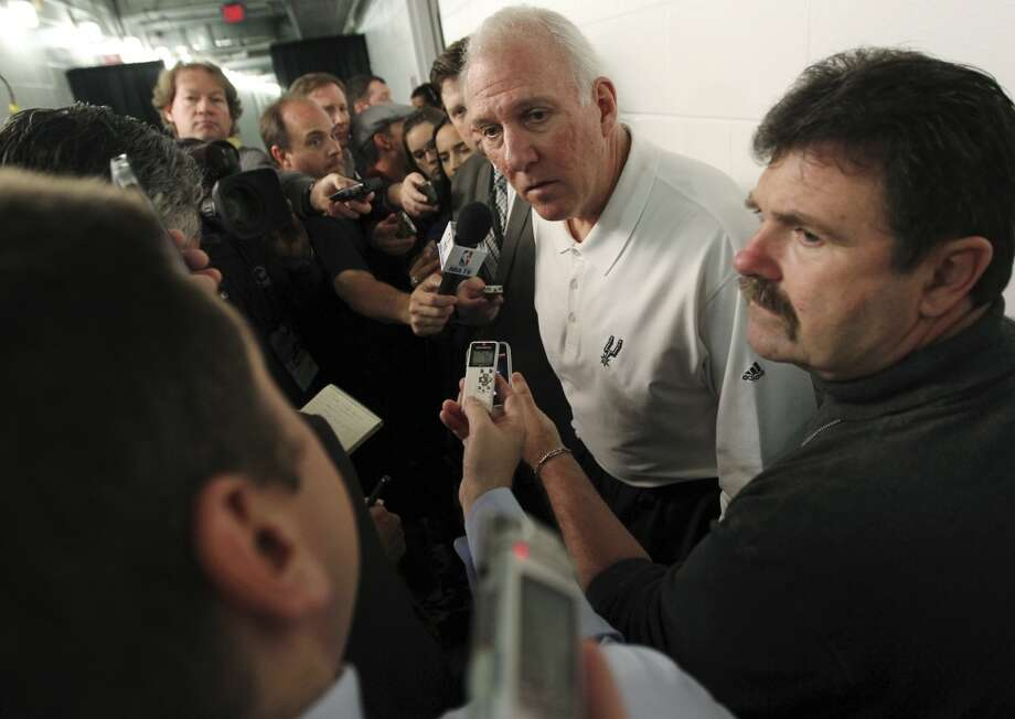 San Antonio Spurs head coach Gregg Popovich speaks to reporters before an NBA basketball game against the Miami Heat, Thursday, Nov. 29, 2012, in Miami. Commissioner David Stern said the Spurs will be punished by the league for their decision to send Tim Duncan, Tony Parker, Manu Ginobili and Danny Green home and not make them available to play against the Heat.