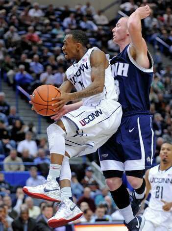 Connecticut's Ryan Boatright, left, drives past New Hampshire's Chandler Rhoads during the second half of an NCAA college basketball game in Hartford, Conn., Thursday, Nov. 29, 2012. Boatright scored a team-high 19 points in Connecticut's 61-53 victory. (AP Photo/Fred Beckham) Photo: Fred Beckham, Associated Press / FR153656 AP