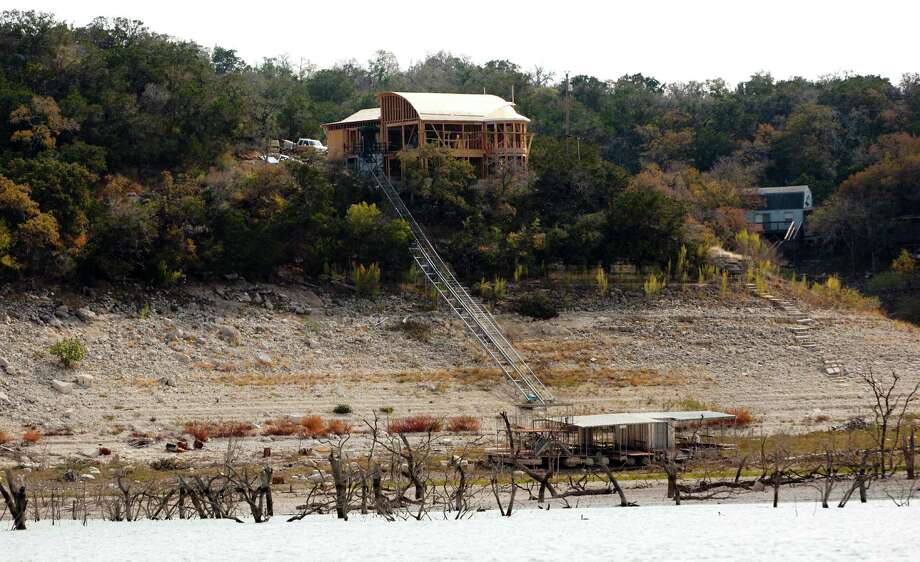 A still-under-construction home is seen on Medina Lake Thursday Nov. 29, 2012. As of Thursday the lake was 68.99 feet below conservation pool, or 10.93 percent full according to the Texas Water Development Board website www.waterdatafortexas.org. Photo: William Luther, San Antonio Express-News / © 2012 San Antonio Express-News