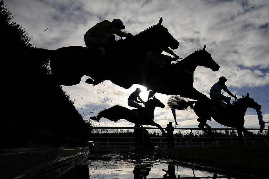 NEWBURY, ENGLAND - NOVEMBER 29:  Runners take the water jump in The Burges Salmon Novices' Limited Handicap Steeple Chase at Newbury racecourse on November 29, 2012 in Newbury, England. (Photo by Alan Crowhurst/Getty Images)  *** BESTPIX *** Photo: Alan Crowhurst, Getty Images