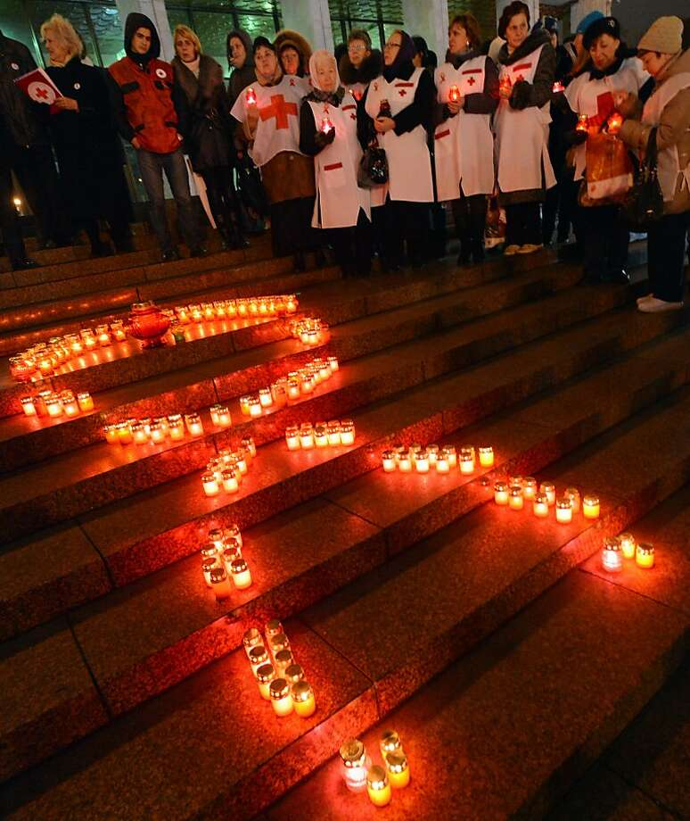 Activist of public organizations and HIV infected people holds candles as they rally in front of a Red Ribbon set with candles in the center of the Ukrainian capital of Kiev on November 29, 2012 to mark the upcoming World AIDS Day on December 1. Ukraine has one of the fastest growing HIV/AIDS epidemics in the world.  TOPSHOTS/AFP PHOTO/ SERGEI SUPINSKYSERGEI SUPINSKY/AFP/Getty Images Photo: Sergei Supinsky, AFP/Getty Images