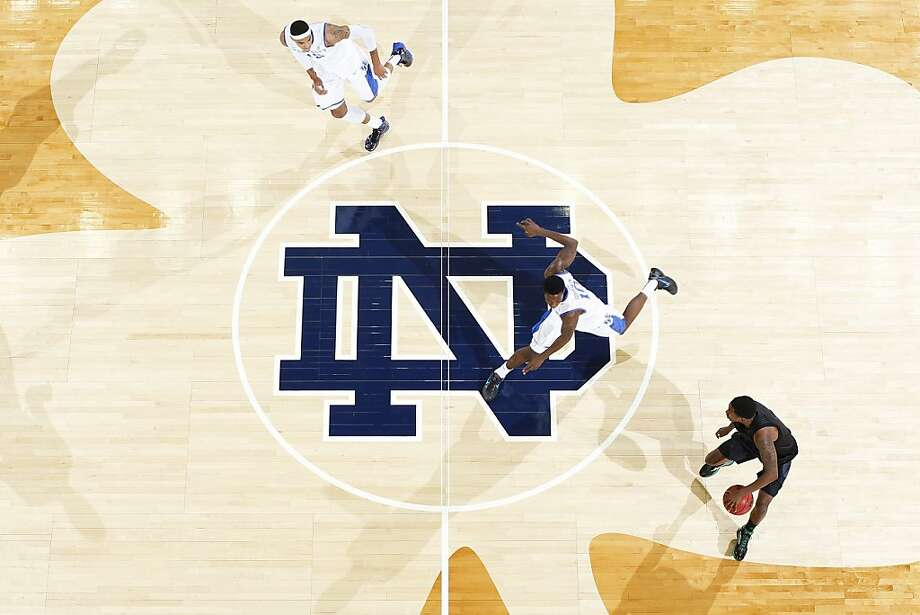SOUTH BEND, IN - NOVEMBER 29: Eric Atkins #0 of the Notre Dame Fighting Irish brings the ball up court against Archie Goodwin #10 of the Kentucky Wildcats during the game at Purcell Pavilion at the Joyce Center on November 29, 2012 in South Bend, Indiana. Notre Dame won 64-50. (Photo by Joe Robbins/Getty Images) Photo: Joe Robbins, Getty Images