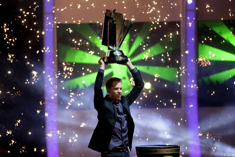 LAS VEGAS, NV - NOVEMBER 29:  2012 NASCAR Sprint Cup Series Champion Brad Keselowski, driver of the #2 Miller Lite Dodge, celebrates on stage with the Sprint Cup Championship trophy during NASCAR After The Lap at PH Live at Planet Hollywood Resort & Casino on November 29, 2012 in Las Vegas, Nevada.  (Photo by John Gurzinski/Getty Images for NASCAR) Photo: John Gurzinski, Getty Images For NASCAR