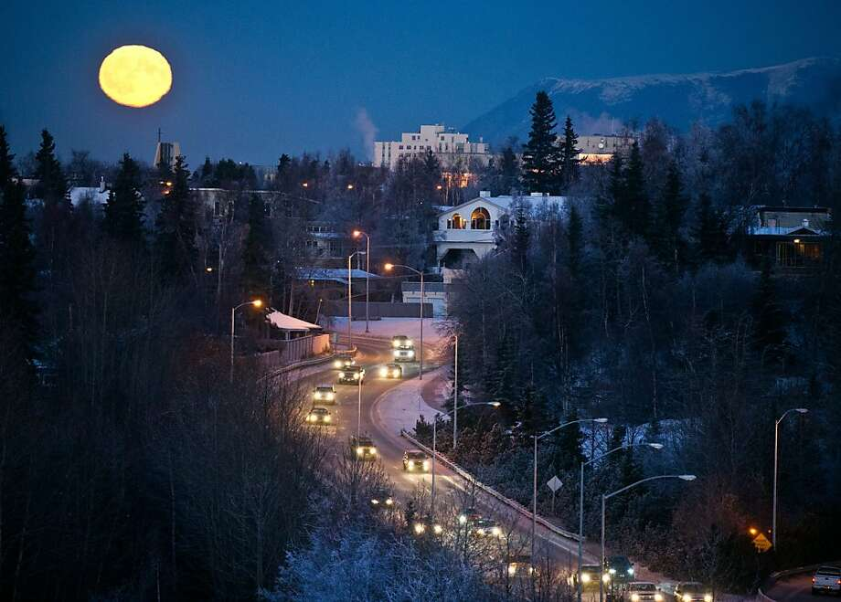 In this photo taken Wednesday, Nov. 28, 2012, a nearly-full moon rises in this view overlooking Minnesota Drive near Westchester Lagoon in Anchorage, Alaska. (AP Photo/Anchorage Daily News, Marc Lester) Photo: Marc Lester, Associated Press