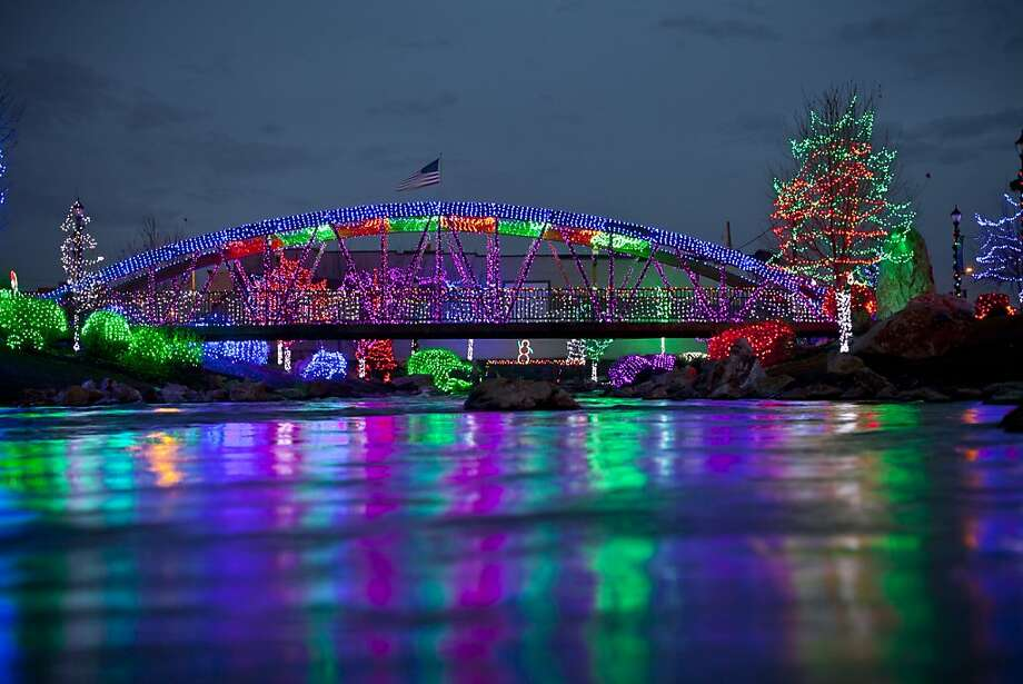 Holiday lights are reflected off Indian Creek in Caldwell, Idaho on Wednesday Nov. 28, 2012. More than 500,000 lights are part of the annual display.  The city of Caldwell will host it's annual Treasure Valley Night Light Parade this coming Saturday.   (AP Photo/The Idaho Statesman,Chris Butler )  LOCAL TV OUT (KTVB 7) Photo: Chris Butler, Associated Press