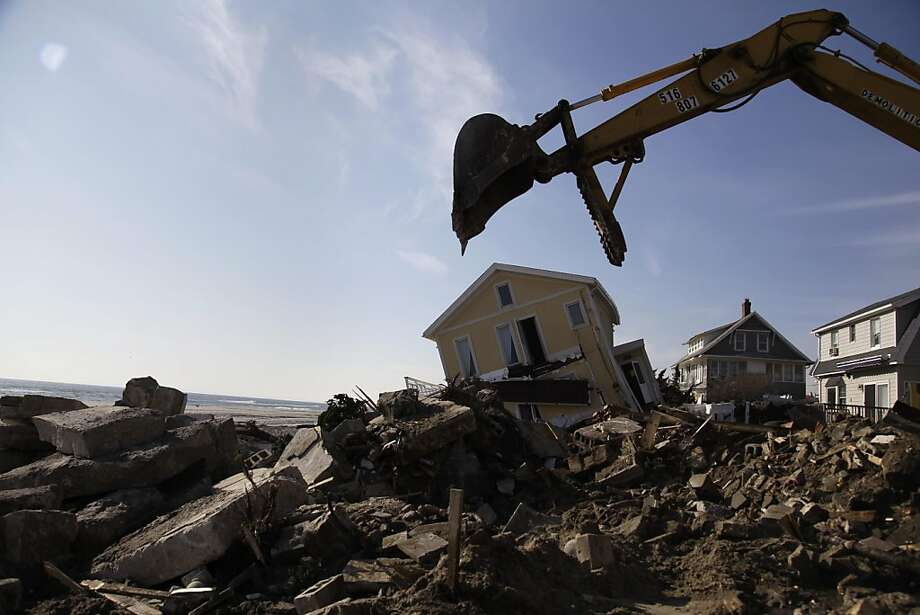Clean up continues on the site of a demolished home on the Rockaway Peninsula in New York, Thursday, Nov. 29, 2012.  Sandy damaged or destroyed 305,000 housing units in New York.  (AP Photo/Seth Wenig) Photo: Seth Wenig, Associated Press