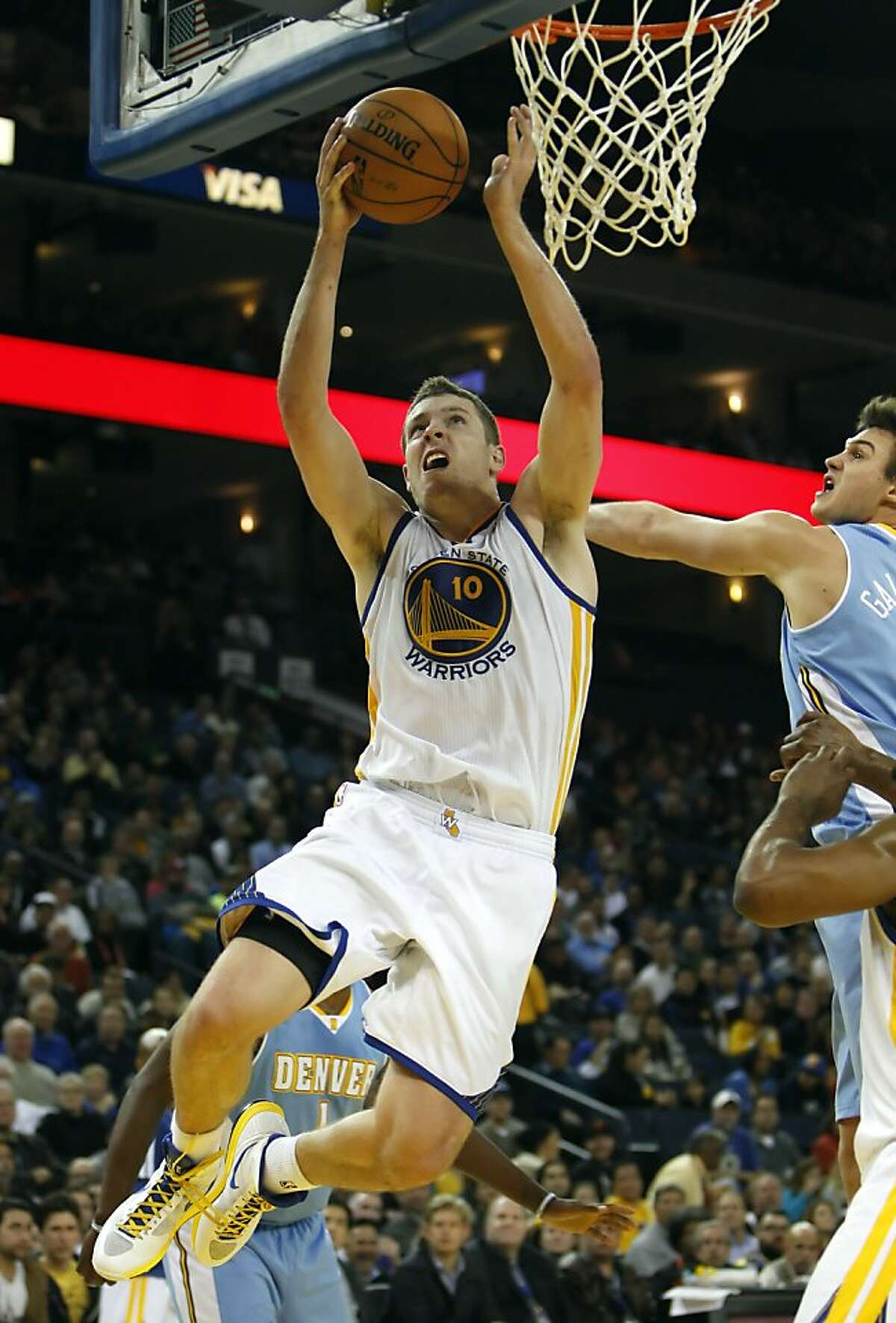 David Lee puts up a shot in the first half, and had the most points for the Warriors heading into the half. The Golden State Warriors played the Denver Nuggets at Oracle Arena in Oakland, Calif., on Thursday, November 29, 2012.