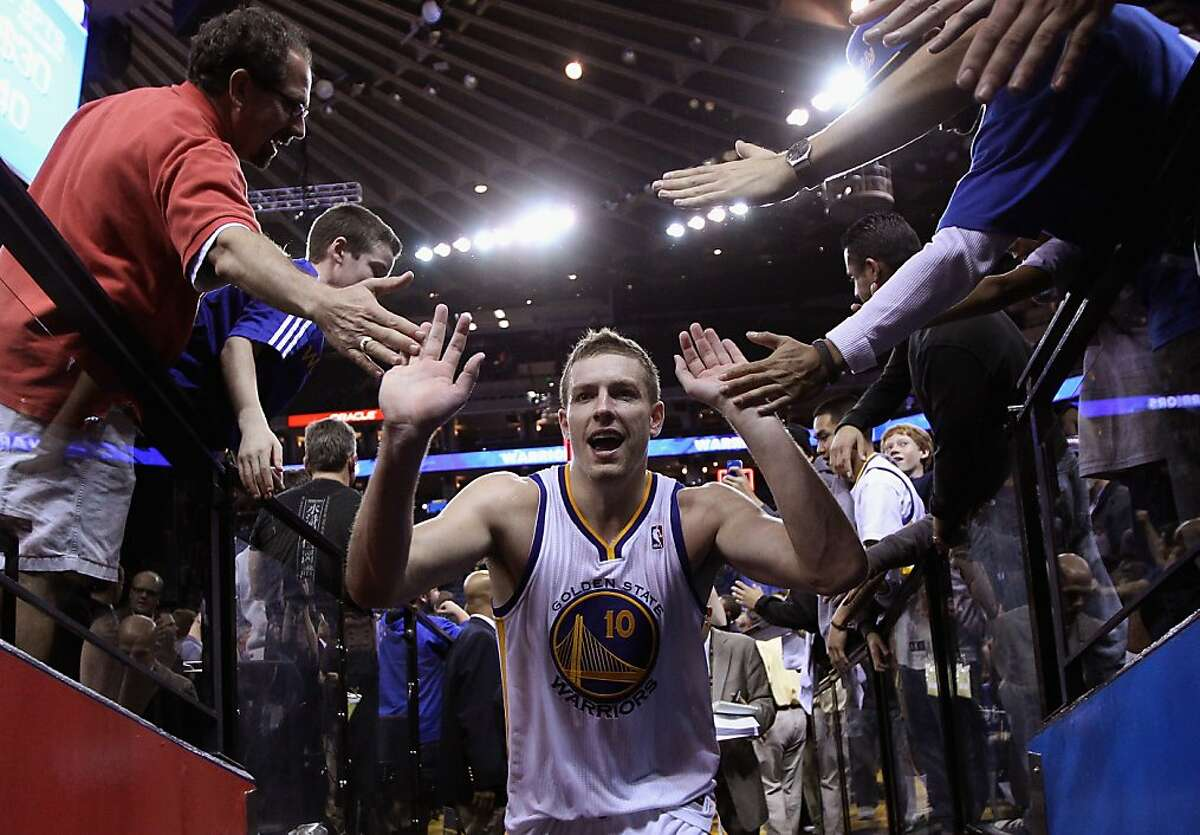 OAKLAND, CA - NOVEMBER 29: David Lee #10 of the Golden State Warriors is congratulated by fans as he heads back to the lockerroom after they beat the Denver Nuggets at Oracle Arena on November 29, 2012 in Oakland, California. NOTE TO USER: User expressly acknowledges and agrees that, by downloading and or using this photograph, User is consenting to the terms and conditions of the Getty Images License Agreement. (Photo by Ezra Shaw/Getty Images)