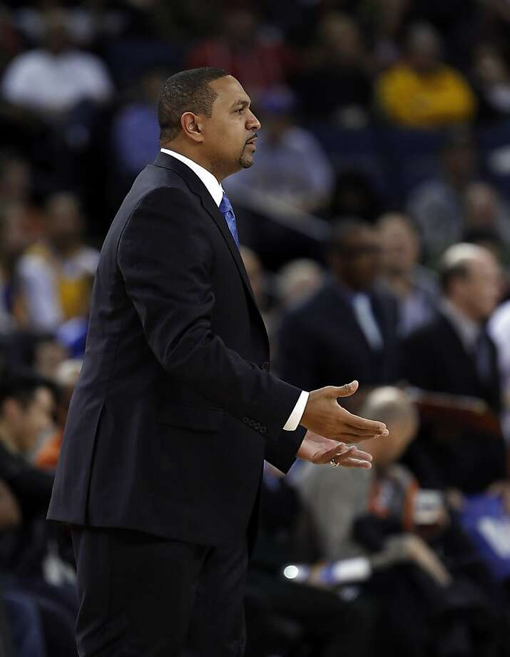 Mark Jackson signals to a ref on a foul call agains the Warriors in the first half. The Golden State Warriors played the Denver Nuggets at Oracle Arena in Oakland, Calif., on Thursday, November 29, 2012. Photo: Carlos Avila Gonzalez, The Chronicle