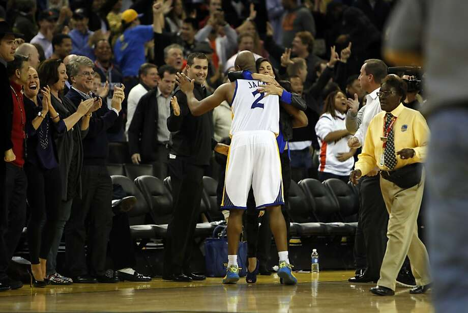 Jarrett Jack hugs fans on the sidelines after the Warriors defeated the Nuggets 106-105 when Andre Iguodala put up a three point shot just after time expired.  The Golden State Warriors played the Denver Nuggets at Oracle Arena in Oakland, Calif., on Thursday, November 29, 2012. Photo: Carlos Avila Gonzalez, The Chronicle