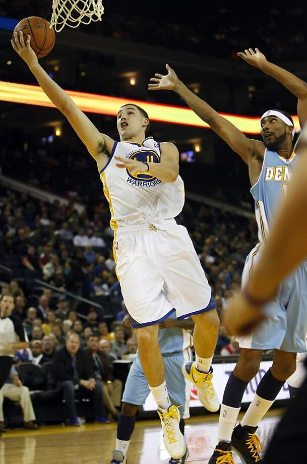 Klay Thompson puts up a shot in the first half. The Golden State Warriors played the Denver Nuggets at Oracle Arena in Oakland, Calif., on Thursday, November 29, 2012. Photo: Carlos Avila Gonzalez, The Chronicle