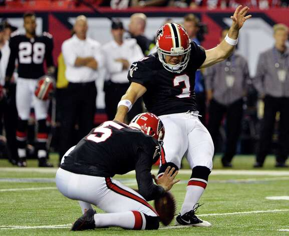 Atlanta kicker Matt Bryant (3) makes a field goal as Matt Bosher (5) holds during the second half of an NFL football game against the New Orleans Saints, Thursday, Nov. 29, 2012, in Atlanta. (AP Photo/Rich Addicks) Photo: Rich Addicks, FRE / FR170246 AP