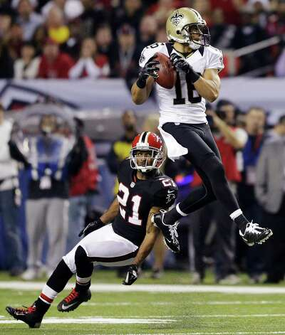 New Orleans Saints wide receiver Lance Moore (16) makes a catch in front of Atlanta Falcons defensive back Chris Owens (21) during the first half of an NFL football game, Thursday, Nov. 29, 2012, in Atlanta. (AP Photo/David Goldman) Photo: David Goldman, STF / AP
