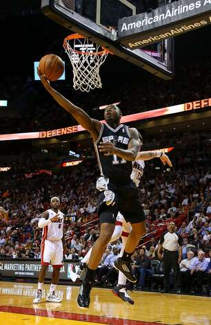 James Anderson #11 of the San Antonio Spurs drives to the basket during a game against the Miami Heat at American Airlines Arena on November 29, 2012 in Miami, Florida.  (Photo by Mike Ehrmann/Getty Images)