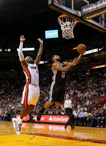 LeBron James #6 of the Miami Heat chases down Patrick Mills #8 of the San Antonio Spurs during a game  at American Airlines Arena on November 29, 2012 in Miami, Florida.