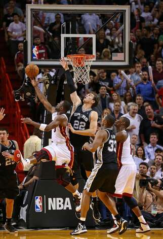 Dwyane Wade #3 of the Miami Heat shoots over Tiago Splitter #22 of the San Antonio Spurs during a game  at American Airlines Arena on November 29, 2012 in Miami, Florida.