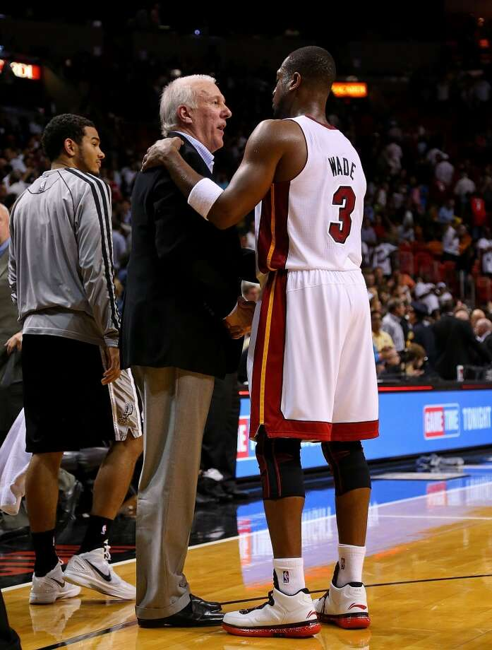 Dwyane Wade #3 of the Miami Heat shakes hands with San Antonio Spurs head coach Greg Popovich during a game  at American Airlines Arena on November 29, 2012 in Miami, Florida.