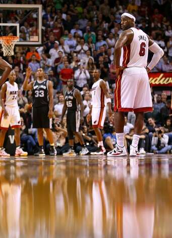 LeBron James #6 of the Miami Heat looks on during a game against the San Antonio Spurs at American Airlines Arena on November 29, 2012 in Miami, Florida.