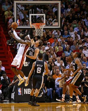 LeBron James #6 of the Miami Heat shoots over Tiago Splitter #22 of the San Antonio Spurs during a game  at American Airlines Arena on November 29, 2012 in Miami, Florida.