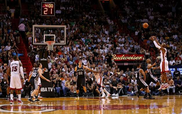 Ray Allen #34 of the Miami Heat shoots a three pointer during a game against the San Antonio Spurs at American Airlines Arena on November 29, 2012 in Miami, Florida.