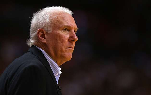 San Antonio Spurs head coach Greg Popovich looks on during a game against the Miami Heat at American Airlines Arena on November 29, 2012 in Miami, Florida.