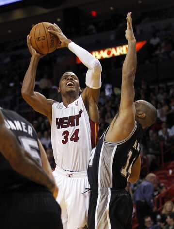 Miami Heat's Ray Allen (34) shoots over San Antonio Spurs' Gary Neal (14) in the second half of an NBA basketball game in Miami, Thursday, Nov. 29, 2012, in Miami. Miami won 105-100. ( AP Photo/Alan Diaz)