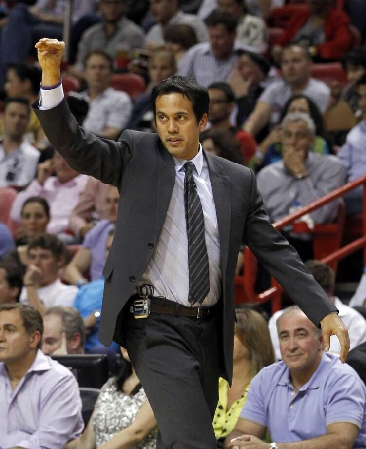 Miami Heat head coach Erik Spoelstra gestures to his players in the second half of an NBA basketball game against the San Antonio Spurs, Thursday, Nov. 29, 2012, in Miami. Miami won 105-100. (AP Photo/Alan Diaz)