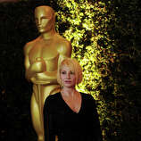 Actress Ellen Barkin arrives at the Academy of Motion Picture Arts and Sciences' 3rd Annual Governors Awards at the Hollywood & Highland Grand Ballroom on November 12, 2011 in Los Angeles, California.  (Photo by Kevin Winter/Getty Images)