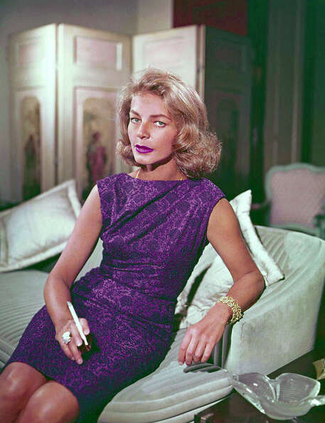 Actress Lauren Bacall, shown seated, at  her Manhattan home in 1965. The voice, the confidence, the