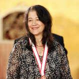 Argentinian pianist Martha Argerich smiles after receiving the gold medal of the Praemium Imperiale at the awarding ceremony in Tokyo, 18 October 2005. A major talent for 50 years.