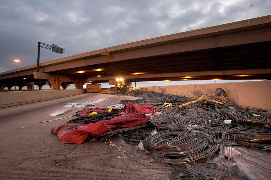 Crews clean up the mess at Interstate 610 at Interstate 10 in Houston. (Cody Duty/Chronicle) / © 2012 Houston Chronicle