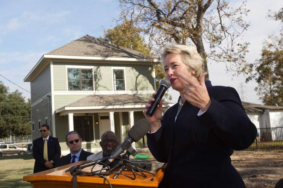 Mayor Annise Parker speaks during the unveiling of a pair of zero energy homes by HOUZE in Independence Heights Thursday, Nov. 29, 2012, in Houston. The initial rollout of HOUZE homes, using energy-wise next generation building systems, materials and technologies, was developed through a partnership with the City of Houston. The homes are designed to be so energy efficient that they can put energy back into the grid. ( Brett Coomer / Houston Chronicle ) (Houston Chronicle)