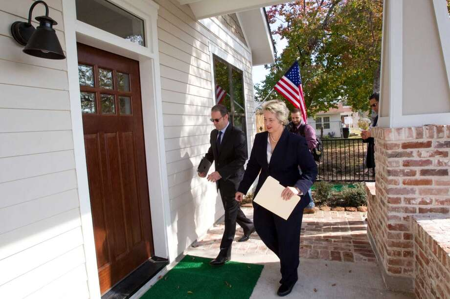 David Goswick, left, CEO of HOUZE, walks with Mayor Annise Parker to the front door of one of the new zero energy homes built by HOUZE in Independence Heights Thursday, Nov. 29, 2012, in Houston. The initial rollout of HOUZE homes, using energy-wise next generation building systems, materials and technologies, was developed through a partnership with the City of Houston. The homes are designed to be so energy efficient that they can put energy back into the grid. ( Brett Coomer / Houston Chronicle ) (Houston Chronicle)