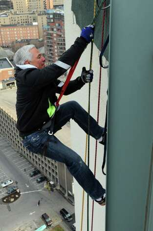 Bobby Valentine rappels from the top of the Landmark Building in Stamford on Friday, November 30, 2012, as practice for Heights and Lights on Sunday, December 2, when Valentine, New York Yankees General Manager Brian Cashman, and Stamford police officer Heather Franc will rappel at 5 p.m. Photo: Lindsay Niegelberg / Stamford Advocate