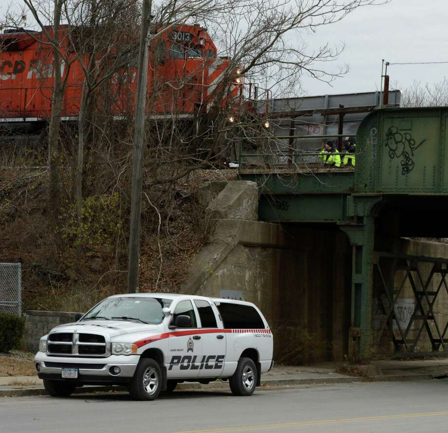 New York State Police and Railroad Police investigate a fatal accident on the rail bed near the Edison Avenue overpass in Schenectady, N.Y. Nov 30, 2012.  (Skip Dickstein/Times Union) Photo: SKIP DICKSTEIN / 00020302A
