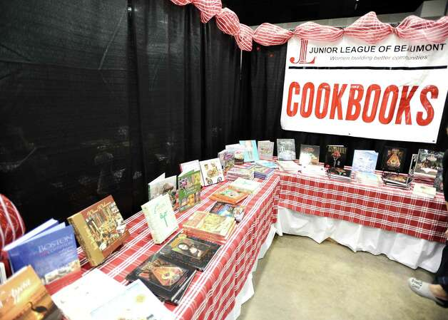 Custom cookbooks from the Junior League are available for purchase during the Main Street Market on Thursday, November 29, 2012.  The market, presented by the Junior League of Beaumont, opened Thursday night, continues from 10 a.m. to 7 p.m. Friday and Saturday and 11 a.m. to 5 p.m. Sunday at the Beaumont Civic Center. Friday morning at 10 a.m., guests can take part in the Holiday Happy Hour brunch, which includes a style show and entertainment. On Saturday, Jingle and Mingle with a style show, entertainment, children's workshop and story time. Santa will be available from 10 a.m. to 2 p.m. Saturday for photos with kids. On Sunday, go Cruisin' to Christmas with a style show and entertainment. Throughout the four-day event, vendors will offer jewelry, accessories, clothing, shoes, handbags, maternity items, children's clothing, unique toys, home and holiday décor, food items, wine and more. Admission is $5 for adults and free for children 12 and younger. Photo taken: Randy Edwards/The Enterprise Photo: Randy Edwards