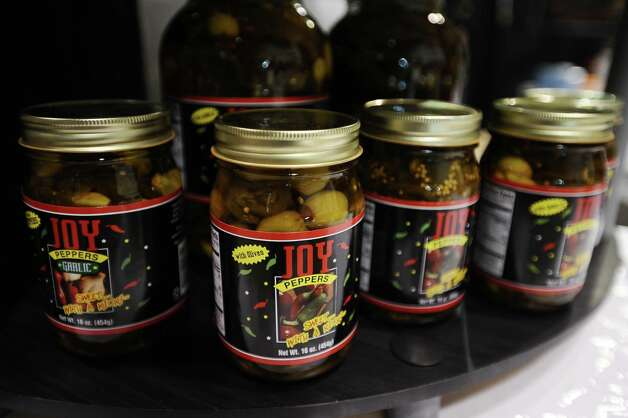 Amazing jelly's and jalapeno combinations from Joy Peppers are available for purchase during the Main Street Market on Thursday, November 29, 2012.  The market, presented by the Junior League of Beaumont, opened Thursday night, continues from 10 a.m. to 7 p.m. Friday and Saturday and 11 a.m. to 5 p.m. Sunday at the Beaumont Civic Center. Friday morning at 10 a.m., guests can take part in the Holiday Happy Hour brunch, which includes a style show and entertainment. On Saturday, Jingle and Mingle with a style show, entertainment, children's workshop and story time. Santa will be available from 10 a.m. to 2 p.m. Saturday for photos with kids. On Sunday, go Cruisin' to Christmas with a style show and entertainment. Throughout the four-day event, vendors will offer jewelry, accessories, clothing, shoes, handbags, maternity items, children's clothing, unique toys, home and holiday décor, food items, wine and more. Admission is $5 for adults and free for children 12 and younger. Photo taken: Randy Edwards/The Enterprise Photo: Randy Edwards