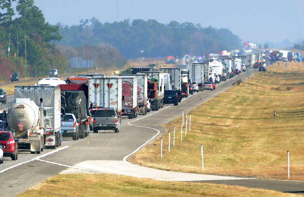 Traffic builds up on the east bound lane of Interstate 10 on Thanksgiving day. Heavy fog and speeders are said to be the causes of the wreck that involved more than 100 cars. Several tractor trailers, a thanker truck and bus were also involved in the pile up.  Photo taken Thursday, November 22, 2012 Guiseppe Barranco/The Enterprise Photo: Guiseppe Barranco, STAFF PHOTOGRAPHER / The Beaumont Enterprise