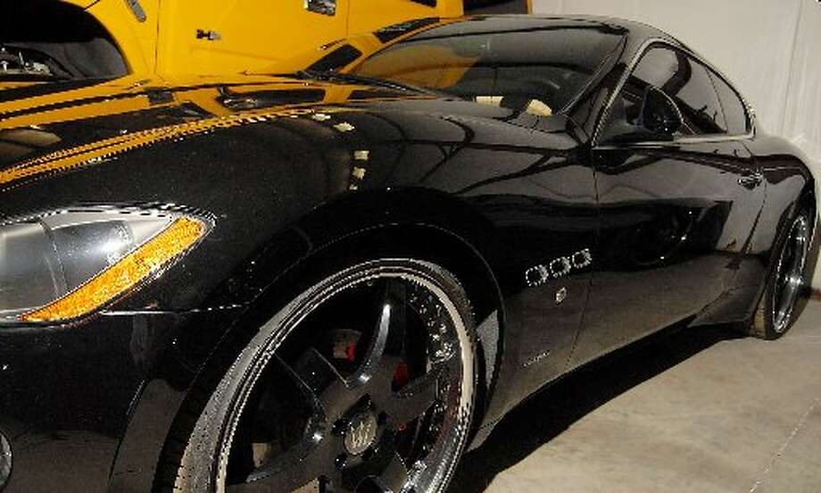 A 2008 Maserati belonging to reputed drug boss Raul Madrigal sits at a storage facility after being confiscated by the feds  (Houston Chronicle)