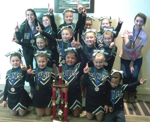 The New Milford Saints' youth cheerleaders earned a divisional title recently at the New England regional competition and will compete Dec. 6-8, 2012 for a national championship in Florida. Among those lending their talents to the effort have been, from left to right, front row, Johssa Daniels, Amelia Define, Kimberly Hernandez, Lindsay Kessman and Kayla Green; middle row,  Samantha Primavera, Jordyn Daab, Christiana Blank and Emily Dawson; and, back row, coach Danielle Bissonette, Catherine Peek, Ali Primavera, Brittney Ek, Jeanette Byron and coach Sydney Altieri. Absent were head coach Kirsten Daab and coach Gail Dawson.  Courtesy of the New Milford Saints Photo: Contributed Photo
