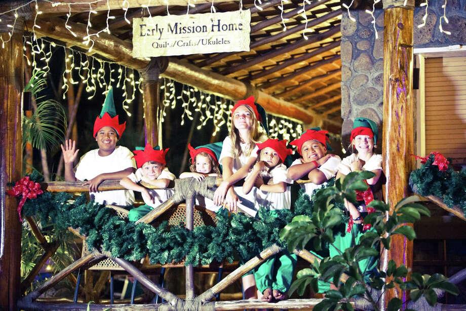 "Musical performances highlight the Polynesian Cultural Center's ""Christmas in Polynesia,"" a 25-minute canoe ride on select nights Dec. 7-22. (Polynesian Cultural Center)"