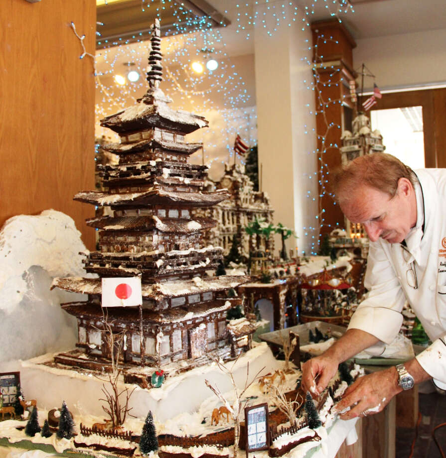 Chef Ralf Bauer touches up a Japanese pagoda, the latest addition to his annual Gingerbread Village exhibition at the Sheraton Princess Kaiulani. (Starwood Waikiki)